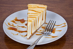 Cheesecake With Caramel Drizzled Stock Photography