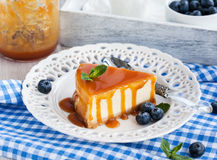 Cheesecake with caramel sauce Stock Images