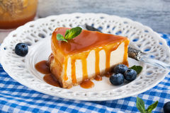 Cheesecake with caramel sauce Stock Image