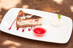 Cheesecake with chantilly cream and coulis Stock Images