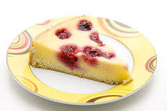 Cheesecake with cherries. On ceramics plate royalty free stock images