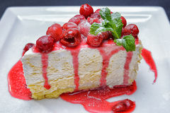 Cheesecake with cherries and mint royalty free stock images