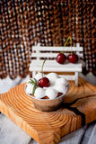 Cheesecake with cherries in tartlets.On wooden frame interesting shapes Stock Photography