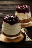 Cheesecake with cherry jelly in glass jars. Stock Images