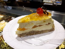 Cheesecake. A cheesecake with a cherry on top Stock Image