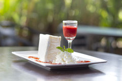 Cheesecake with cherry  on wooden table. Royalty Free Stock Image