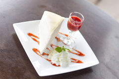 Cheesecake with cherry  on wooden table. Royalty Free Stock Photography
