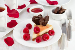 Cheesecake with chocolate hearts and raspberries Stock Image