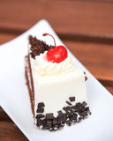Cheesecake with Chocolate Sauce and Cherries Stock Photography