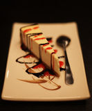 cheesecake with chocolate sauce on a white plate Royalty Free Stock Photography