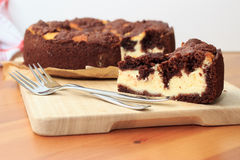 Cheesecake with chocolate shortcrust pastry and chocolate crumble. Arranged on a wooden board Stock Photos