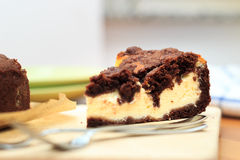 Cheesecake with chocolate shortcrust pastry and chocolate crumble. Arranged on a wooden board Royalty Free Stock Image