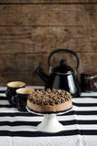 Cheesecake with chocolate, topped with cream and nut on crunchy crust Stock Photo