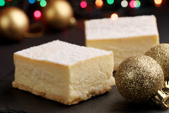Cheesecake and Christmas decorations stock image
