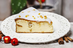 Cheesecake in christmas eve setting Royalty Free Stock Photography