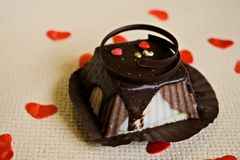 Chocolate cheesecake with small red hearts. Valentine`s Day stock image