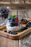 Cheesecake creme parfaits with blueberries and red currant berries stock photos