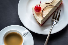 Cheesecake with cup of coffee Stock Photography