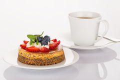 Cheesecake, cup of coffee and spoon Stock Photos