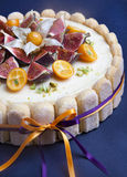 Cheesecake decorated with fig and kumquat Stock Photos