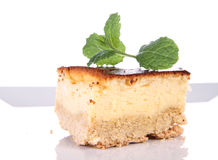 Cheesecake decorated with mint Royalty Free Stock Photos