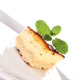Cheesecake decorated with mint Stock Photo