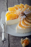 Cheesecake decorated with oranges and physalis. On a plate Stock Image