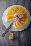 Cheesecake decorated with oranges and physalis. Royalty Free Stock Images