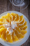 Cheesecake decorated with oranges and physalis. On wooden table Royalty Free Stock Images
