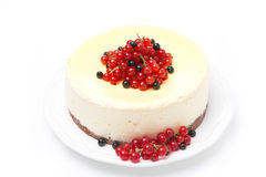 Cheesecake decorated with red and black currants, isolated Stock Photography