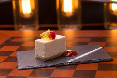Cheesecake dessert. Decorated with raspberry on wooden table Stock Photo