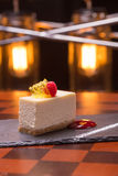 Cheesecake dessert. Decorated with raspberry on wooden table Royalty Free Stock Photography
