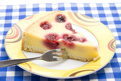 Cheesecake with fork. On ceramics plate Royalty Free Stock Photos