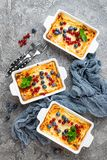 Cheesecake with fresh berries. Cheesecake with blueberry and red currant royalty free stock photo