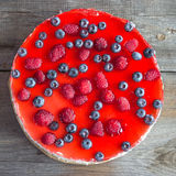 Cheesecake with the fresh raspberries and blueberries. Cheesecake with fresh raspberries and blueberries Stock Images