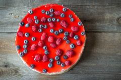 Cheesecake with the fresh raspberries and blueberries. Cheesecake with fresh raspberries and blueberries Stock Photography