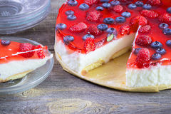 Cheesecake with the fresh raspberries and blueberries.  Stock Photo