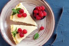 Cheesecake with fresh raspberries Royalty Free Stock Image