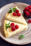 Cheesecake with fresh raspberries Royalty Free Stock Photo