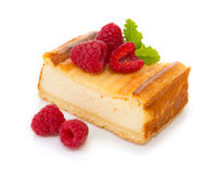 Cheesecake with fresh raspberries  isolated . Royalty Free Stock Photos
