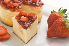 Cheesecake with fresh strawberries stock image