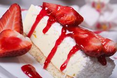 Cheesecake with fresh strawberries and coconut Stock Images