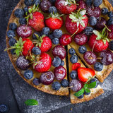 Cheesecake with fresh summer berries. Top view. Square image Stock Images