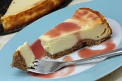 Cheesecake with fruit coulis Royalty Free Stock Image