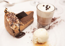 Cheesecake with ice-cream and hot cacao Stock Photos