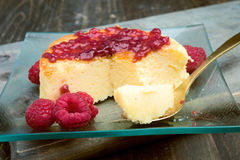 Cheesecake with jam on wooden table Royalty Free Stock Photo