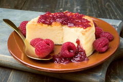 Cheesecake with jam on wooden table Royalty Free Stock Photos