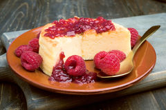 Cheesecake with jam on wooden table Royalty Free Stock Image
