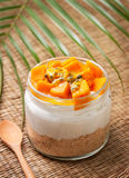 Cheesecake in a  jar with mango and passionfruit Stock Photos
