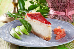 Cheesecake with jelly and strawberry slices on a Stock Images